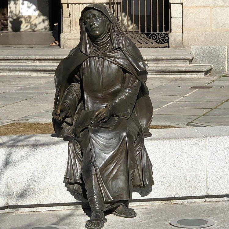 Outdoor life-size sitting bronze Teresa sculpture