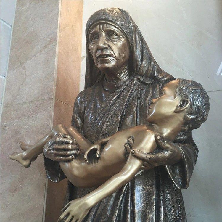 Newly designed bronze mother Teresa sculpture holding a child