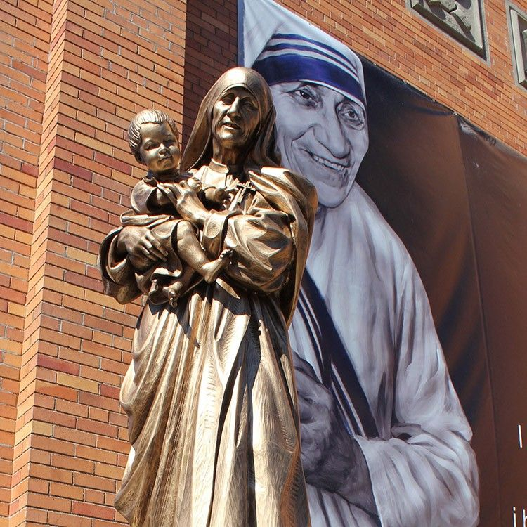 The gracious bronze religious saint Teresa statue