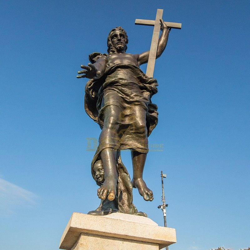 Famous outdoor bronze statue of Jesus holding a cross for sale
