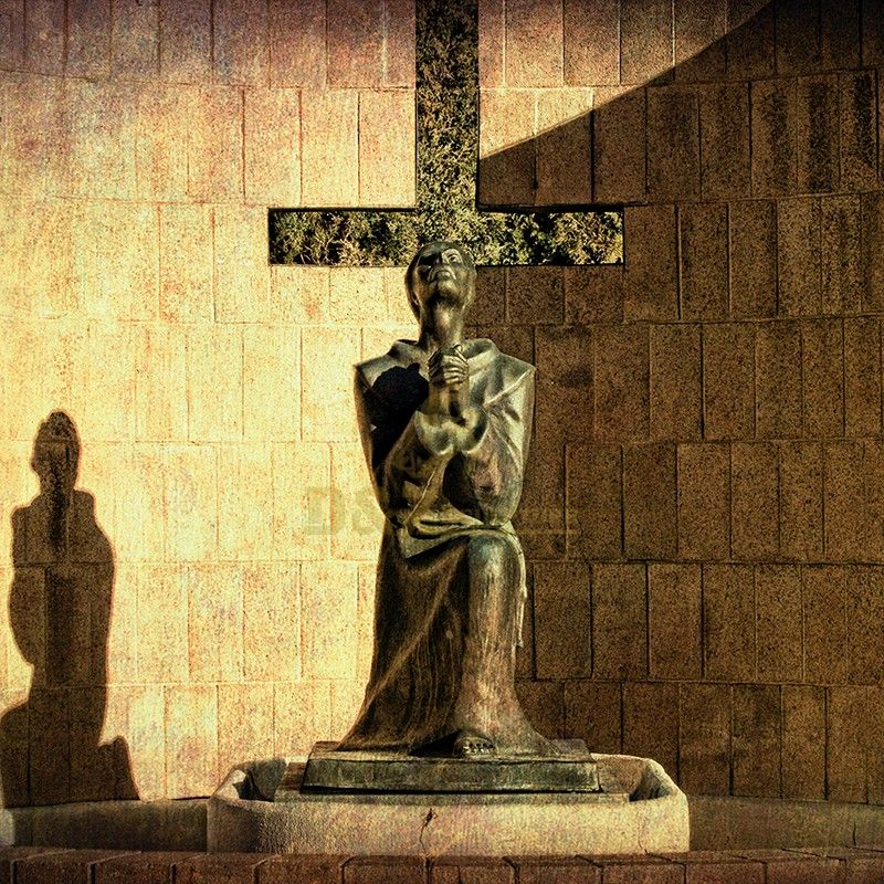 Life-size statue of Saint Francis praying before the cross for sale