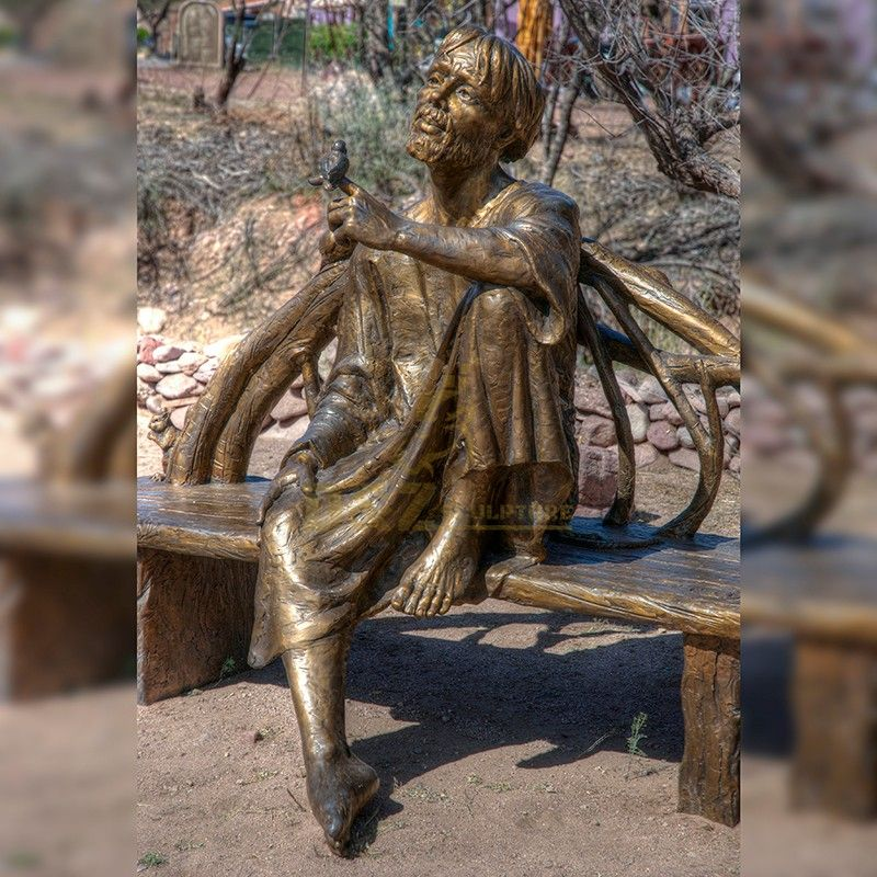 Bronze statue of st francis in assisi and bird sitting on a chair for sale