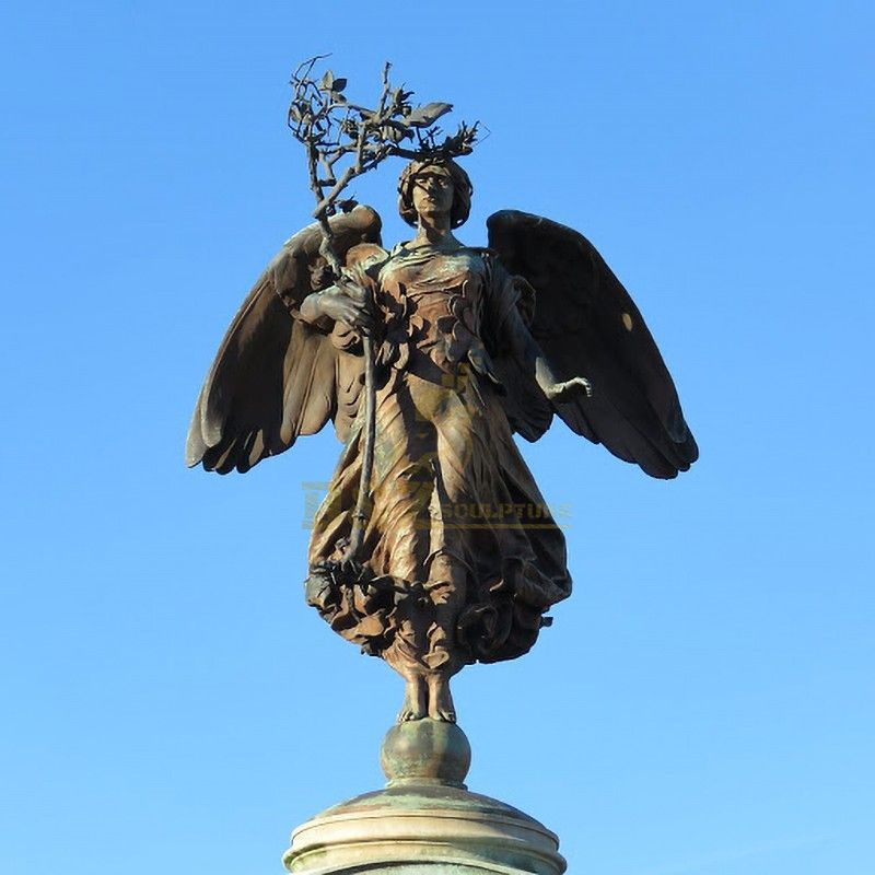 Large angel statue standing on a ball holding a tree branch for sale