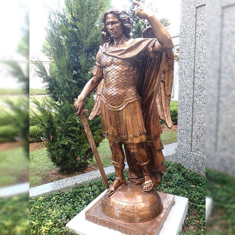 Bronze statue of Archangel Saint Michael stepping on a ball in garden decoration