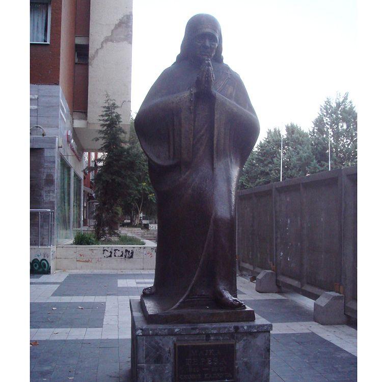 Bronze teresa sculpture with hands folded for prayer
