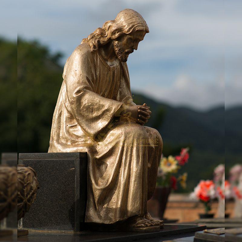 jesus statue on park bench