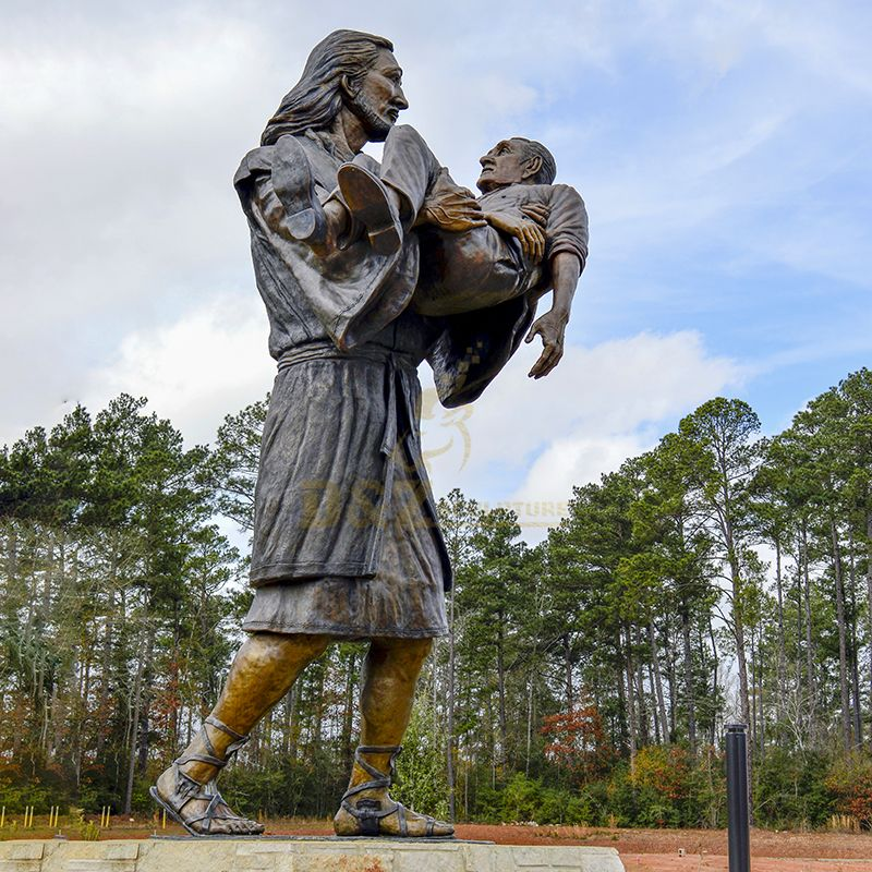 jesus carrying a man statue